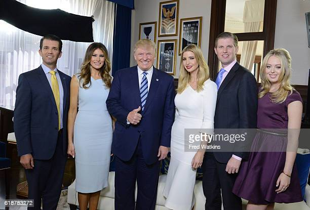 Walt Disney Television via Getty Images NEWS The Trump family gathers for a photo at the opening of the Trump International Hotel in Washington DC...