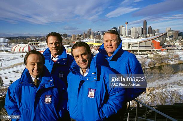 Winter Olympics 11/1419/87 Jm McKay Frank Gifford Al Michaels Keith Jackson pose in front of the Saddle Dome in Calgary for the 1988 Winter Olympics...