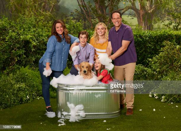 HOUSEWIFE Walt Disney Television via Getty Images's American Housewife stars Katy Mixon as Katie Otto Daniel DiMaggio as Oliver Otto Julia Butters as...