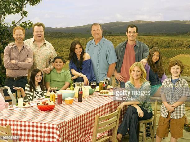 "Walt Disney Television via Getty Images's ""Modern Family"" stars Jesse Tyler Ferguson as Mitchell, Ariel Winter as Alex, Eric Stonestreet as Cameron,..."