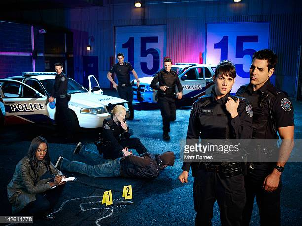 BLUE Walt Disney Television via Getty Images's Rookie Blue stars Enuka Okuma as Traci Nash Gregory Smith as Dov Epstein Charlotte Sullivan as Gail...