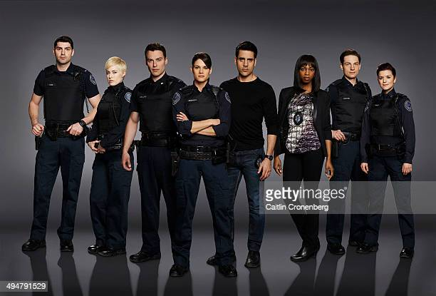 BLUE Walt Disney Television via Getty Images's Rookie Blue stars Travis Milne as Chris Diaz Charlotte Sullivan as Gail Peck Peter Mooney as Nick...