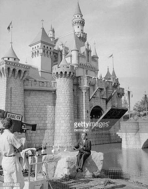 Walt Disney the cartoonistproducer and lately creator of Disneyland the 160acre $17000 playground for children sits in front of his Fantasyland...