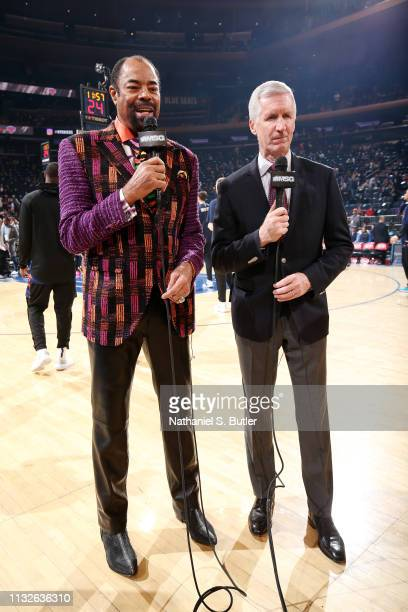 Walt Frazier and Mike Breen look on prior to the game between the LA Clippers and New York Knicks on March 24, 2019 at Madison Square Garden in New...