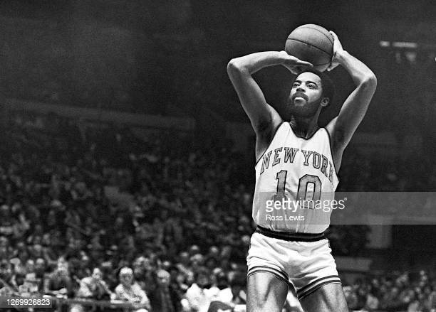 Walt Frazier, New York Knickerbockers guard, shoots the basketball during an NBA game against the Buffalo Braves at Madison Square Garden, New York...