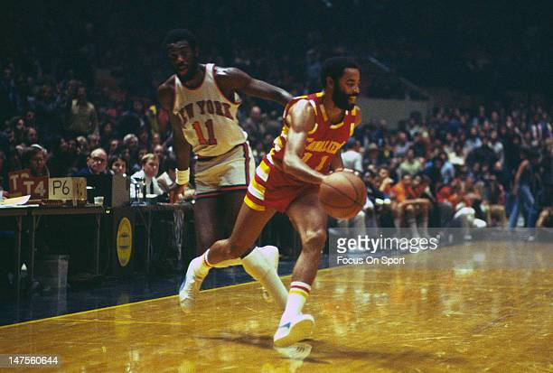 Walt Frazier of the Cleveland Cavaliers drives on Bob McAdoo of the New York Knicks during an NBA basketball game circa 1978 at Madison Square Garden...