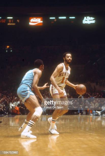 Walt Frazier of the New York Knicks dribbles the ball against the Buffalo Braves during an NBA basketball game circa 1978 at Madison Square Garden in...