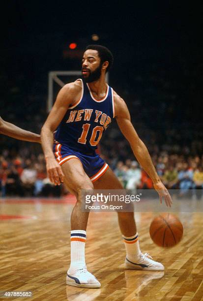 Walt Frazier of the New York Knicks dribbles the ball against the Baltimore Bullets during an NBA basketball game circa 1971 at the Baltimore Civic...