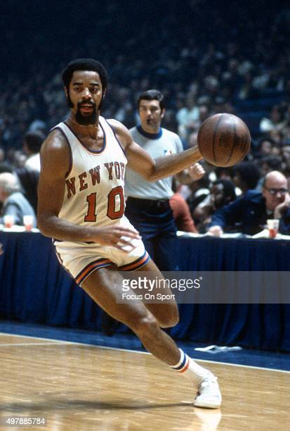 Walt Frazier of the New York Knicks dribbles the ball during an NBA basketball game circa 1975 at Madison Square Garden in the Manhattan borough of...