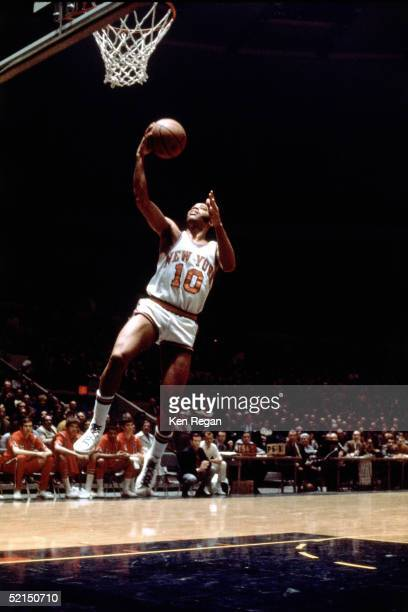 Walt Frazier of the New York Knicks drives to the basket for a layup during an NBA game at Madison Square Garden in 1972 in New York New York NOTE TO...