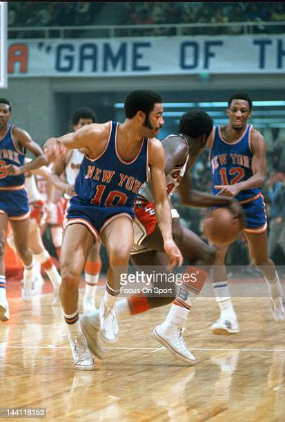 Walt Frazier of the New York Knicks guards Earl Monroe of the Baltimore Bullets during an NBA basketball game circa 1970 at the Baltimore Civic...