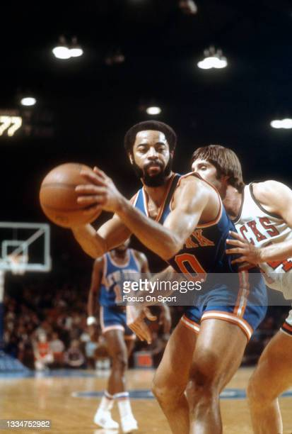 Walt Frazier of the New York Knicks in action against the Milwaukee Bucks during an NBA basketball game circa 1977 at the MECCA Arena in Milwaukee,...