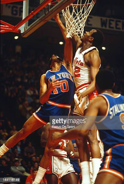 Walt Frazier of the New York Knicks in attempts to shoot over Jim Barnes of the Baltimore Bullets during an NBA basketball game circa 1970 at the...