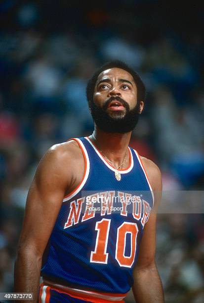 Walt Frazier of the New York Knicks looks on against the Washington Bullets during an NBA basketball game circa 1976 at the Capital Centre in...