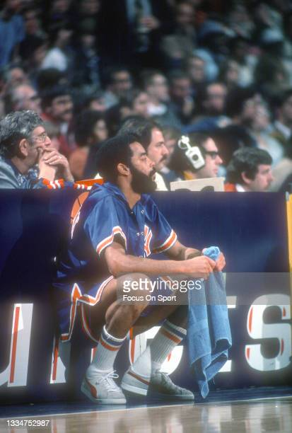 Walt Frazier of the New York Knicks looks on waiting to come into the game against the Washington Bullets during an NBA basketball game circa 1977 at...