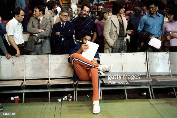 Walt Frazier of the New York Knicks reads the stat sheet after an NBA game NOTE TO USER User expressly acknowledges and agrees that by downloading...