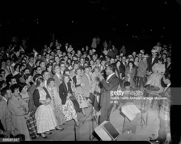 Walt Harper and his band performing for large crowd at Carnegie Tech annual Spring Carnival Pittsburgh Pennsylvania 1955