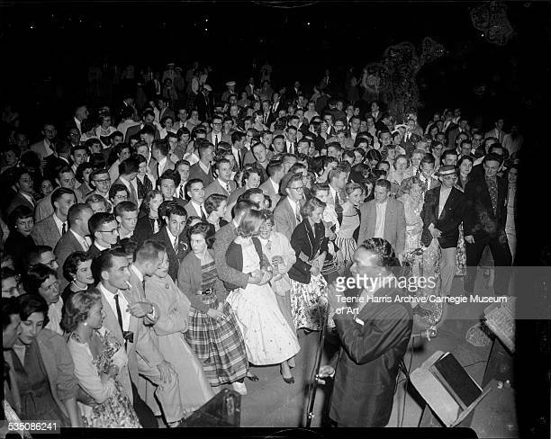 Walt Harper and his band performing in front of crowd at Carnegie Tech's annual Spring Carnival Pittsburgh Pennsylvania 1955