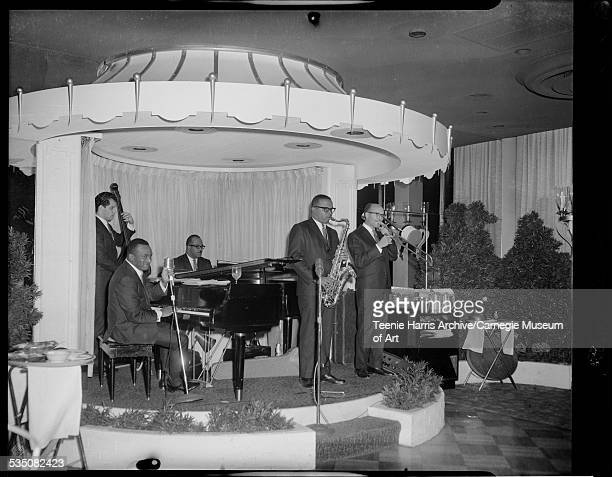 Walt Harper and his band performing on carouselshaped stage with Jerry Elliott on trombone Nate Harper on saxophone Tommy McDaniel on bass and Bert...