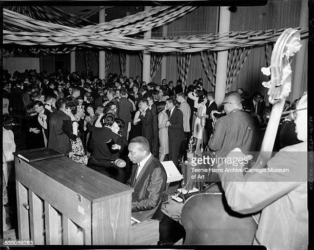 Walt Harper and his band performing to men and women in ballroom decorated with streamers and trophies on stage Pittsburgh Pennsylvania 1962