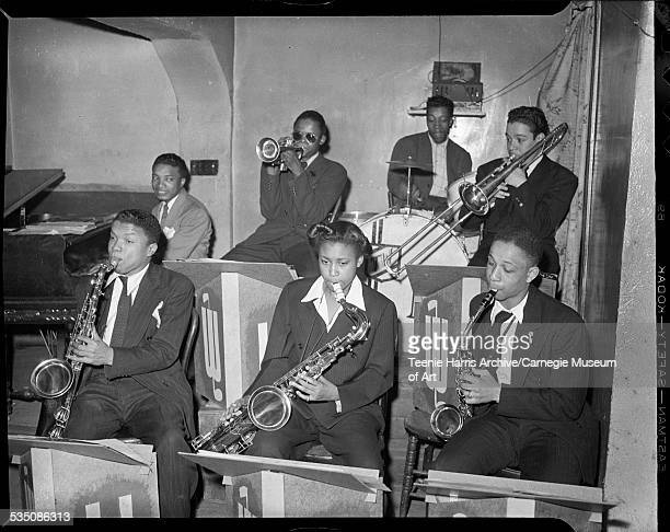 Walt Harper band including Nate Harper on tenor saxophone unknown woman on saxophone Earl Crandall on alto saxophone Walt Harper on piano Tommy...