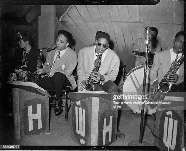 Walt Harper band performing including saxophone players Bradley Bluett Howard Kimbo and Nate Harper and Cecil Brooks on drums performing in interior...