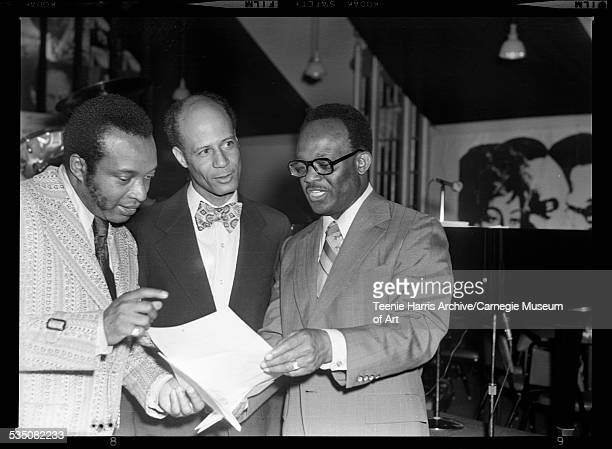 Walt Harper Billy Colbert and Rev Bill Powell examining document in Walt Harper's Attic Pittsburgh Pennsylvania 1973