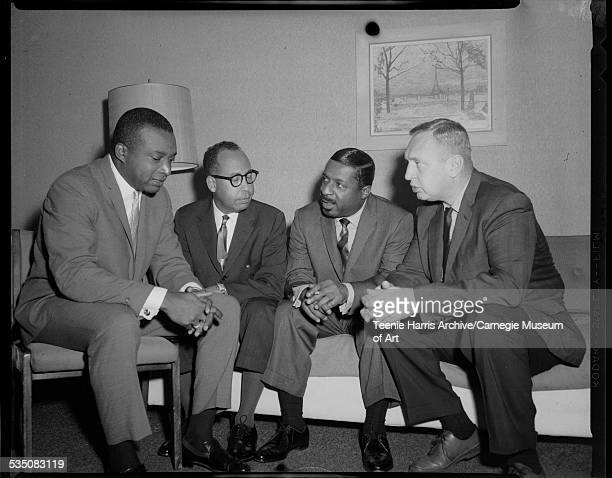 Walt Harper Daniel G 'Dan' Kean of Gulf Oil Erroll Garner and Roy Kohler of Gulf Oil public relations seated in Penn Sheraton Hotel discussing the...