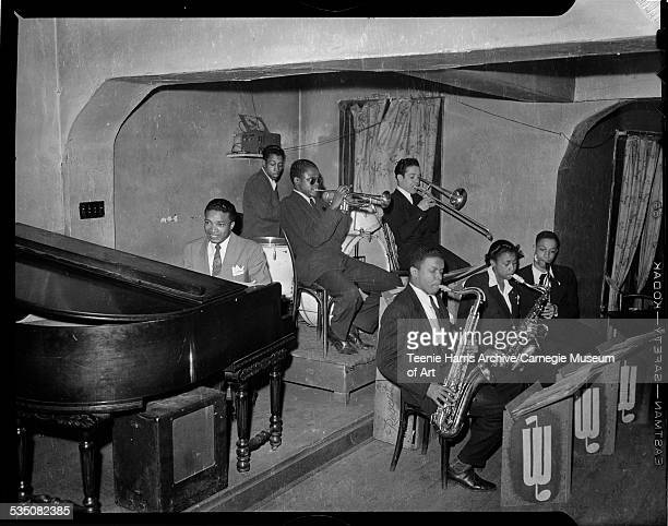 Walt Harper playing piano Nate Harper on tenor saxophone Hosea Taylor on alto saxophone Tommy Turrentine on trumpet Billy 'Stinky' Davis on trombone...