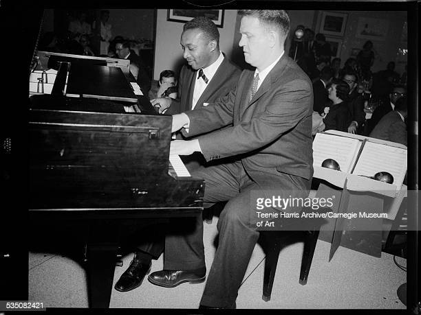 Walt Harper playing piano with Sam Hood during jazz concert in Pittsburgh Press Club Pittsburgh Pennsylvania April 1958
