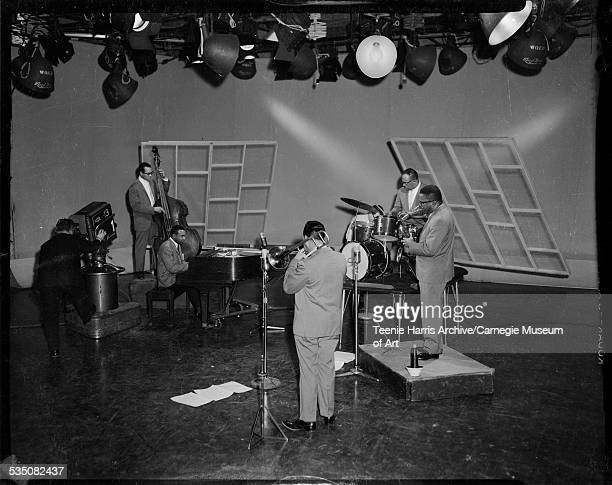 Walt Harper Quintet performing with piano drums trombone saxophone and bass in WQED channel 13 television studio with camera operator on left...