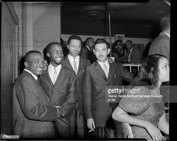 Walt Harper shaking hands with Ahmad Jamal next to Jamal's trio members Israel Crosby and Vernel Fornier in Copa Club for cabaret sponsored by...