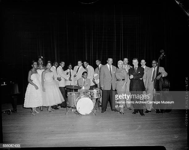 Walt Harper with members of his band including Tiny Irvin Velar wearing dress with dark belt Cecil Brooks on drums Walt Harper wearing dark trousers...