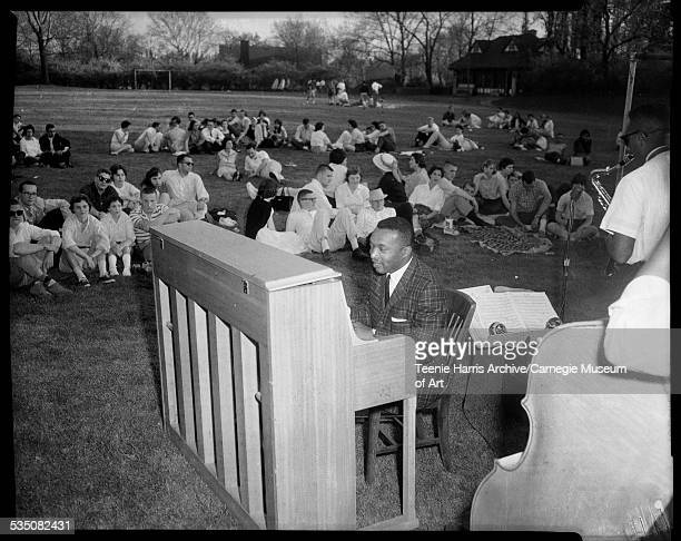 Walt Harper with quintet performing outdoors with audience seated on grass Pittsburgh Pennsylvania 1960