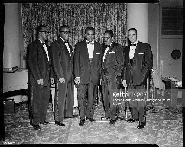 Walt Harper's band wearing tuxedos including drummer Bert Logan Jr saxophone player Nate Harper pianist Walt Harper bass player Billy Lewis and...