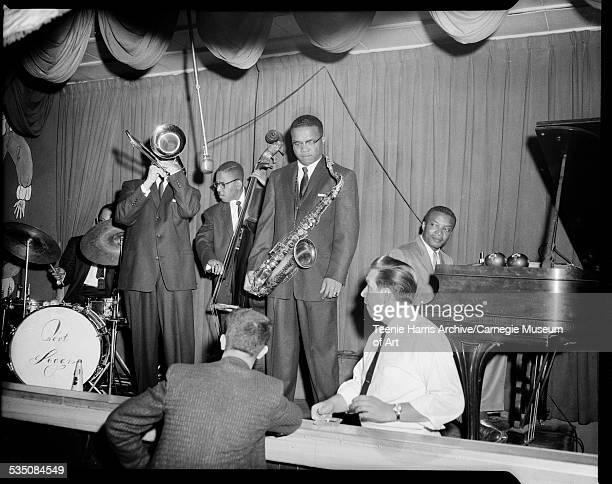 Walt Harper's band with Bert Logan Jr on drums Jon Morris on trombone Billy Lewis on bass Nate Harper on saxophone and Walt Harper on piano...