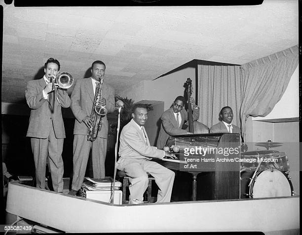 Walt Harper's jazz band performing with Jon Morris on trombone Nate Harper on saxophone Walt Harper on piano Bill Lewis on bass and Harold 'Brushes'...