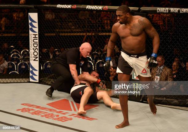 Walt Harris celebrates after his TKO victory over Cyril Asker of France in their heavyweight bout during the UFC Fight Night event at the Singapore...