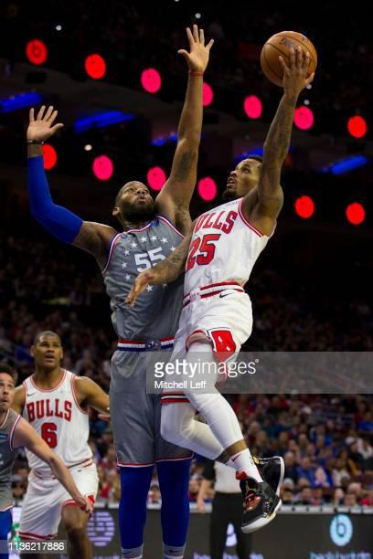 Walt Lemon Jr #25 of the Chicago Bulls shoots the ball against Greg Monroe of the Philadelphia 76ers in the first quarter at the Wells Fargo Center...