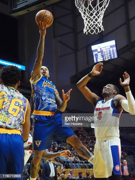 Walt Lemon Jr #4 of the Fort Wayne Mad Ants battles Dakaral Allen of the Grand Rapids Drive on December 28 2019 at Memorial Coliseum in Fort Wayne...