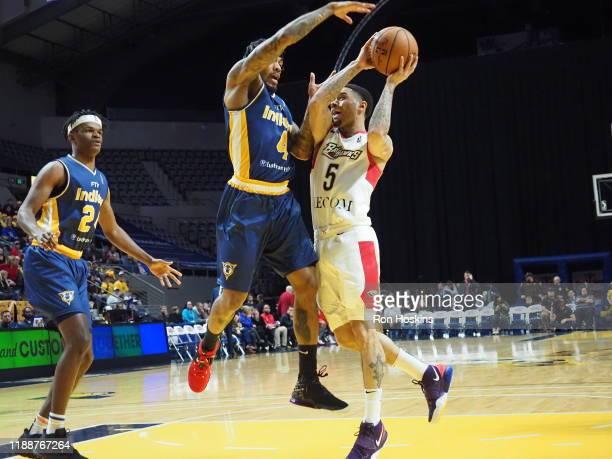 Walt Lemon Jr #4 of the Fort Wayne Mad Ants battles Josh Gray of the Erie Bayhawks on December 14 2019 at Memorial Coliseum in Fort Wayne Indiana...