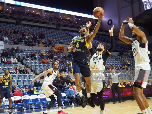 Walt Lemon Jr #4 of the Fort Wayne Mad Ants battles Tyler Ennis of the Raptors 905 on December 7 2019 at Memorial Coliseum in Fort Wayne Indiana NOTE...