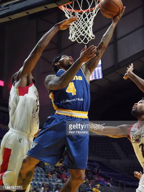 Walt Lemon Jr #4 of the Fort Wayne Mad Ants battles Vitto Brown of the Erie Bayhawks on December 14 2019 at Memorial Coliseum in Fort Wayne Indiana...