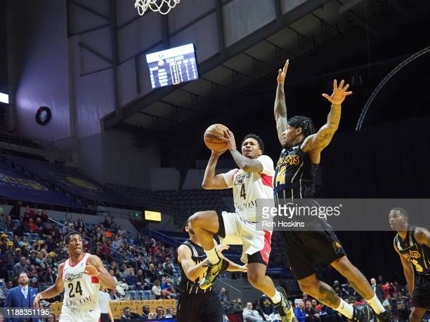 Walt Lemon Jr #4 of the Fort Wayne Mad Ants shoots the ball against Jalen Adams of the Erie Bayhawks on December 13 2019 at Memorial Coliseum in Fort...