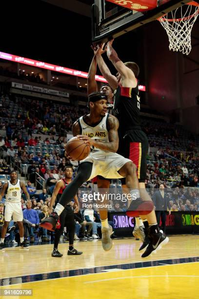 Walt Lemon Jr of the Fort Wayne Mad Ants battles two Erie Bayhawks defenders in the 2018 Eastern Conference semifinals of the NBA G League on April 3...