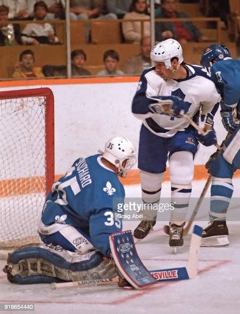Walt Poddubny of the Toronto Maple skates against Dan Bouchard of the Quebec Nordique during NHL preseason game action on September 28 1985 at Maple...