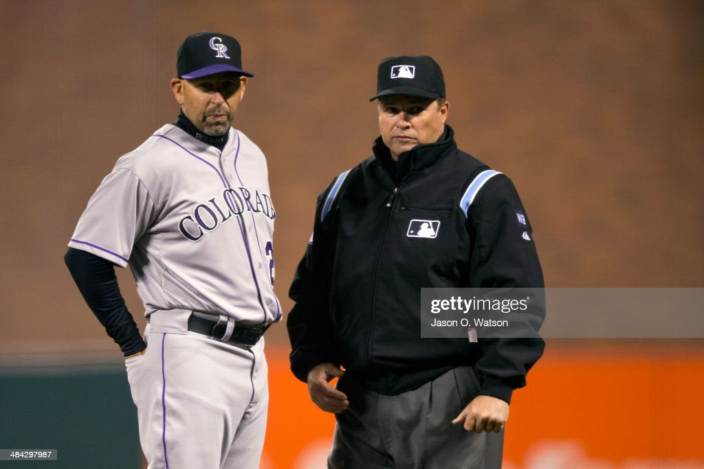 Walt Weiss #22 of the Colorado Rockies argues a call with umpire Marvin Hudson #51 at first base during the seventh inning against the San Francisco Giants at AT&T Park on April 11, 2014 in San Francisco, California.