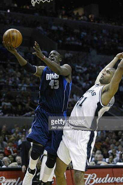 Walt Williams of the Dallas Mavericks goes to the basket against Tim Duncan of the San Antonio Spurs in Game two of the Western Conference Finals...