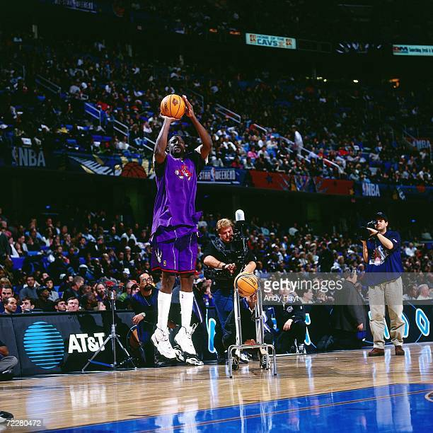 Walt Williams of the Toronto Raptors shoots a jump shot during the 1997 ATT Three Point Shootout on February 8 1997 at the Gund Arena in Cleveland...