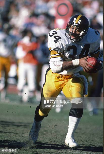 Walter Abercrombie of the Pittsburgh Steelers carries the ball against the Los Angeles Raiders during an NFL football game circa 1984 at the Los...